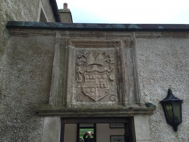 The 17th century armorial panel from Breckness House, now above the E entrance to Skaill House.