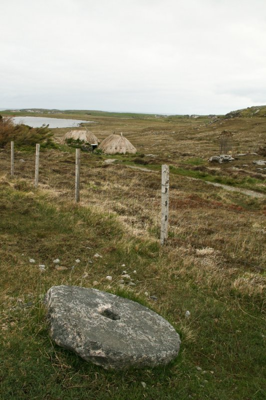View of millstone with mill buildings in background;  Horizontal Click Mill, South Shawbost, Lewis.