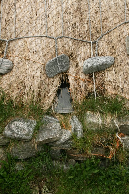 Detail of thatch with stone weights;  Horizontal Click Mill, South Shawbost, Lewis.