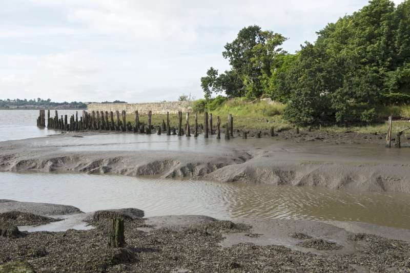 Forth estuary and remains of timber wharf or quay, view from north east.The timber quayside deck onto which cargo to be shipped in and out would have been stored is now gone.