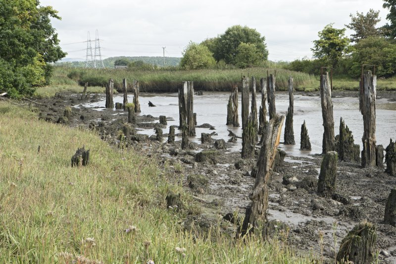Remains of timber wharf or quay posts, view from south west