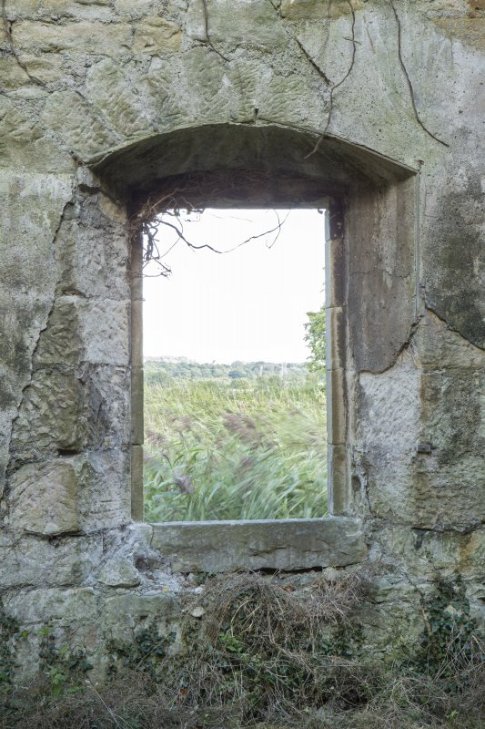 Distillery building, south range, grain miling area. Detail of arched window in east wall