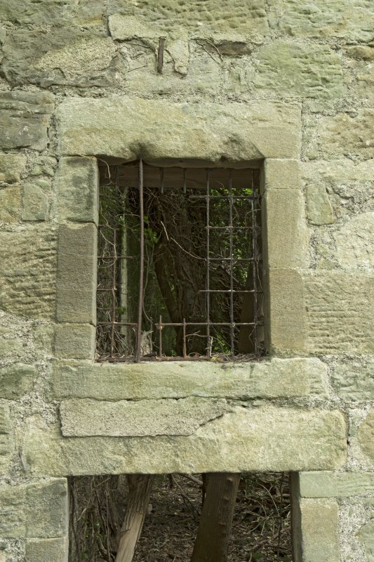 Malt barn/  store, west wall, detail of outside of window with glazing bars at 1st floor level