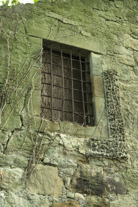 Malt barn/  store, west wall, detail of barred window at 1st floor level