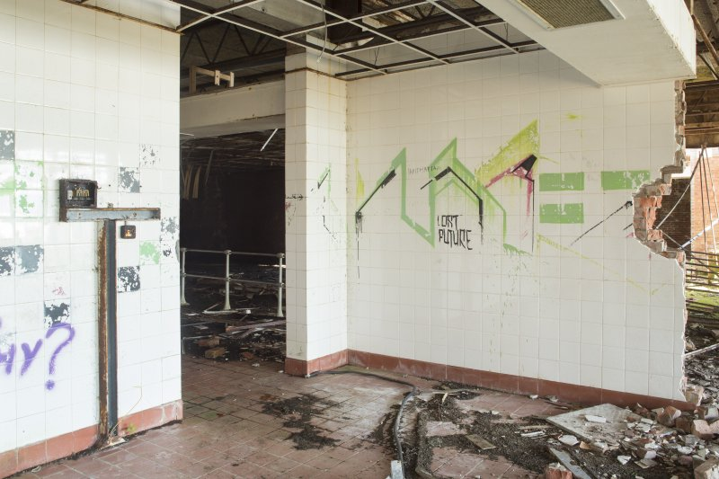 Central block. View of graffiti art by Derm from north.