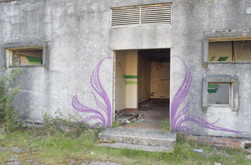 Central block. View of graffiti art from north east.