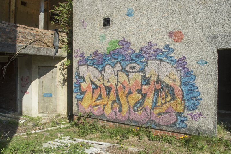 Laundry block. View of graffiti art from south east.