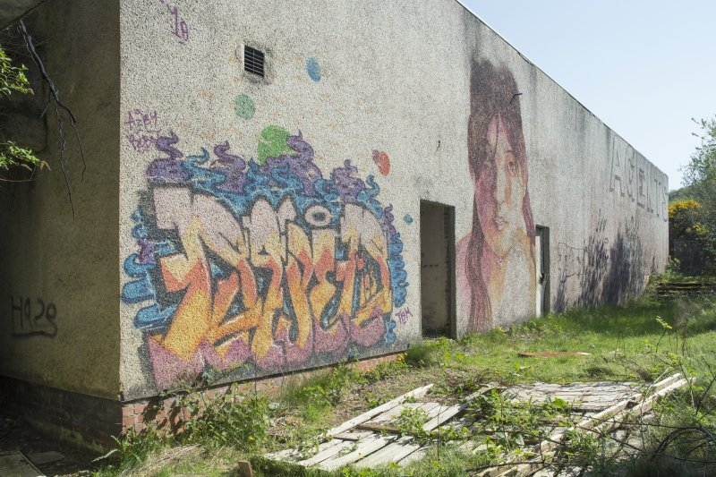 Laundry block. View of graffiti art from south west.