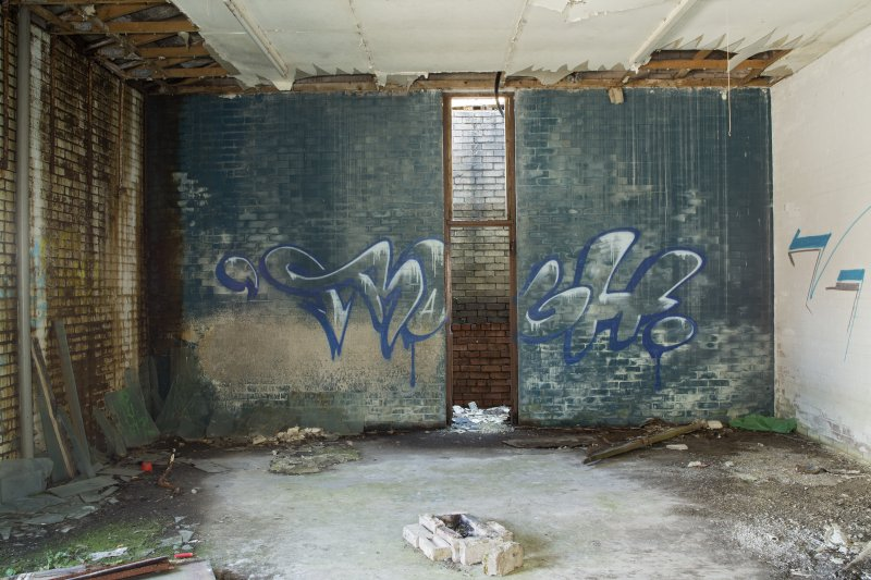 Laundry block. View of graffiti art by Remi/Rough from west.