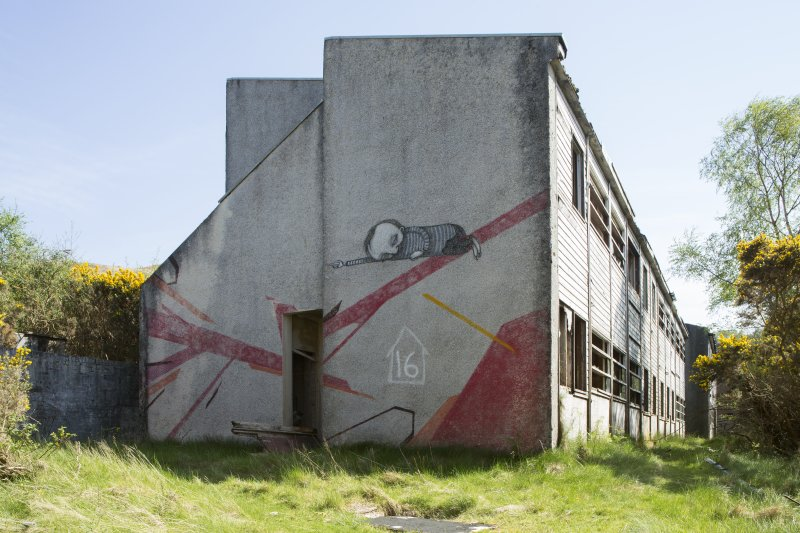 Accommodation block. View of graffiti art by Remi/Rough and Stormie Mills from north west.