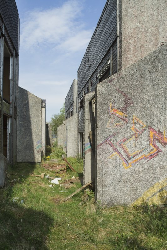 Accommodation block. View of graffiti art by Derm from south.
