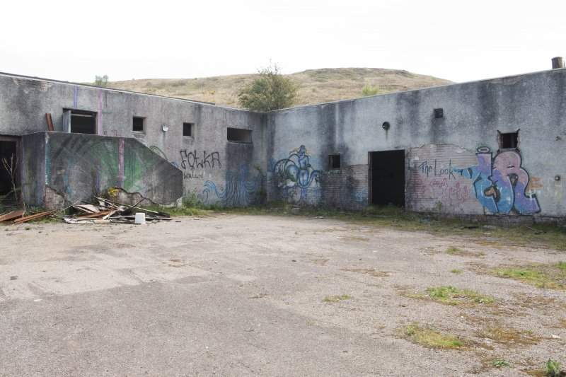 Laundry block. View of graffiti art from north west.