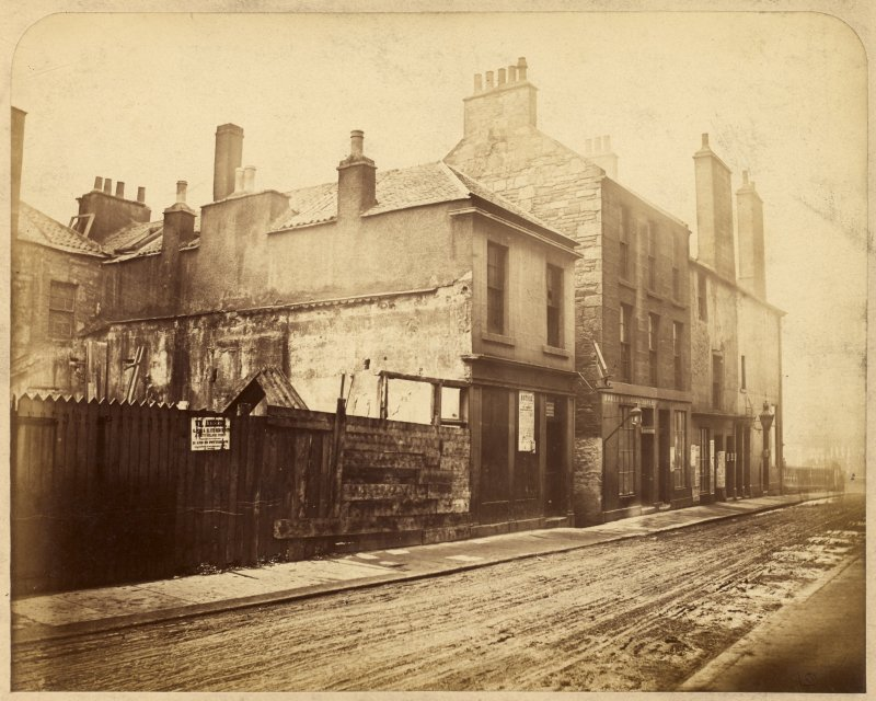 View of houses at junction between North College Street and Hastie's Close, Edinburgh, prior to demolition.
