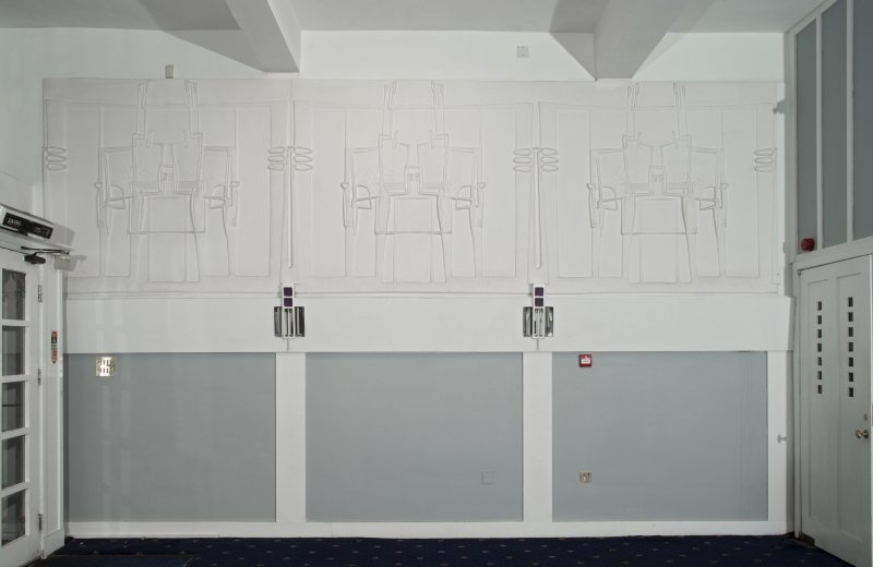 Ground floor, front saloon, view of 3 plaster panels on east wall