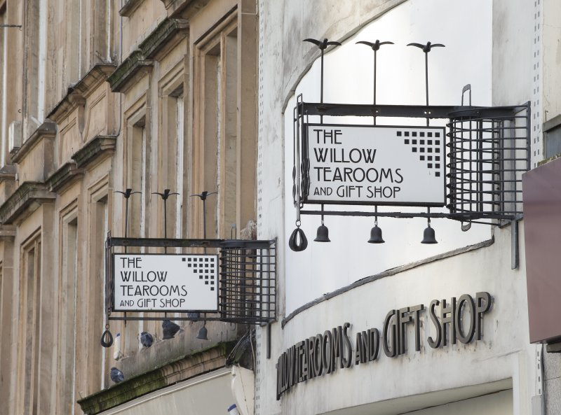 Detail of signs at east and west ends of shop front