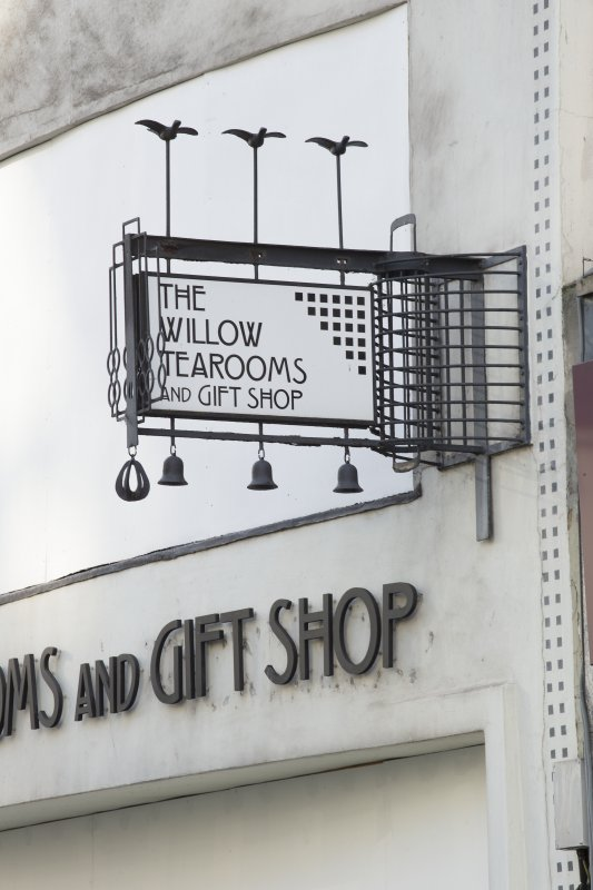 Detail of sign at west end of shop front