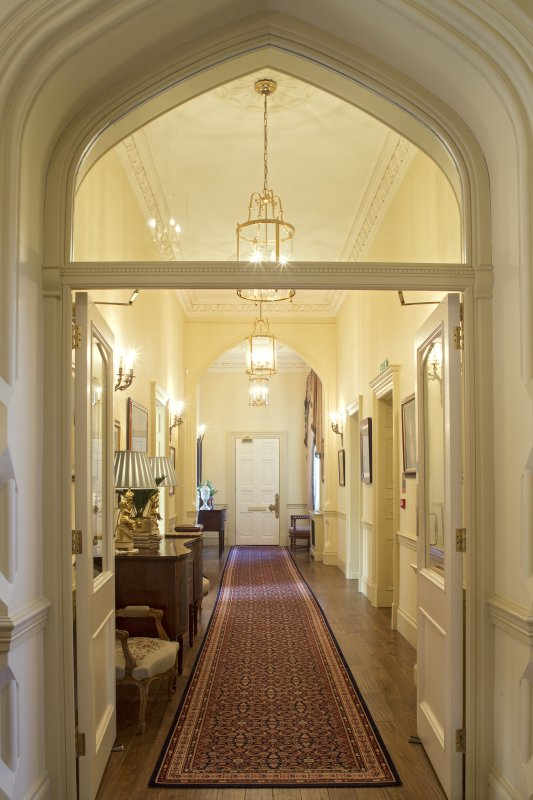 Ground floor. Entrance hall. View along drawing room passage from east.