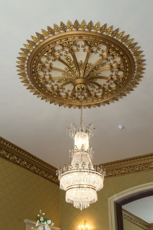 Ground floor. Dining room. Detail of ceiling rose and chandelier.