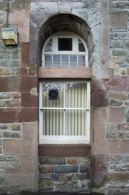 Exterior. Detail of window recess on west elevation.