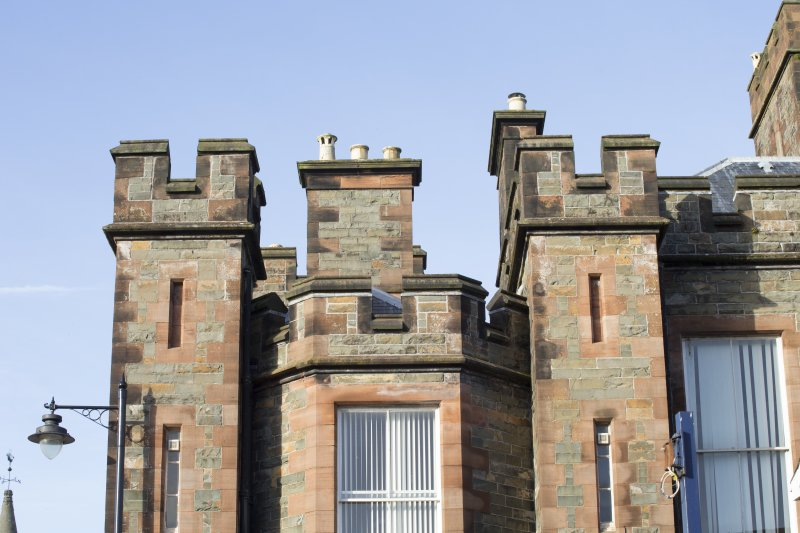 Exterior. Detail of castellations and chimney stacks on south elevation..