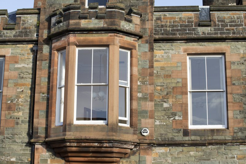 Exterior. Detail of first floor bay window on south elevation.