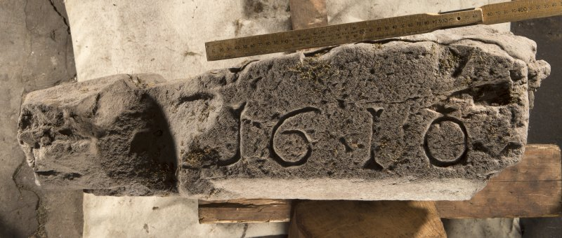 Carpow Pictish cross slab fragment face b, view showing re-use as lintel with chamfer dated 1610 (including scale)