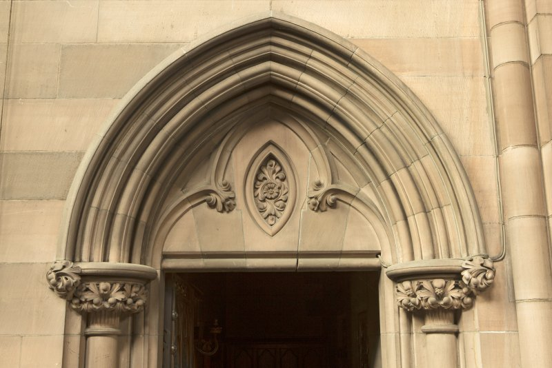 West transept. Door to vestry, detail of pediment.