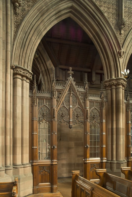 West transept. Screen and arch leading to west entrance.