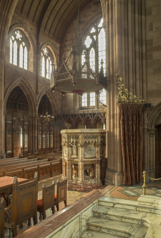 Pulpit and west transept from chancel to north east.