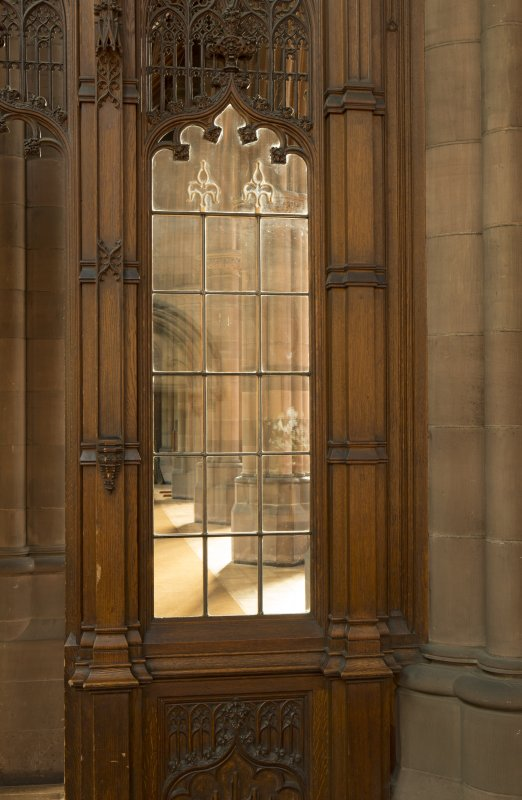 East transept. Glazed screen at south end, view through to east side of nave