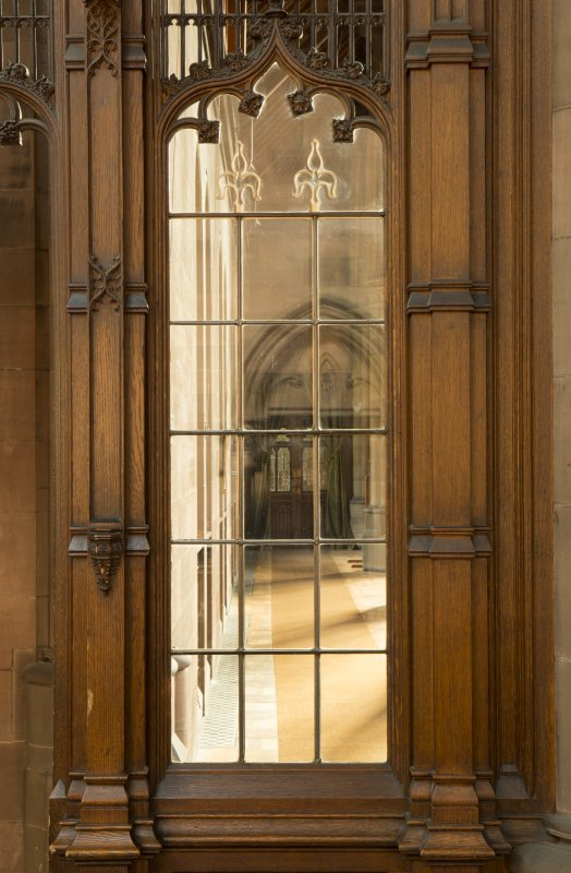 East transept. Glazed screen at south end, view through to east side of nave.