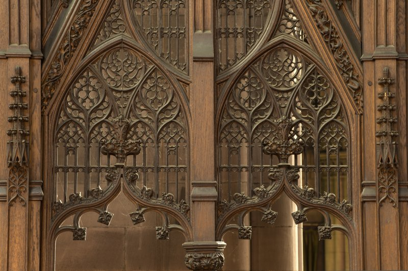 East transept. Screen at south end, tracery.