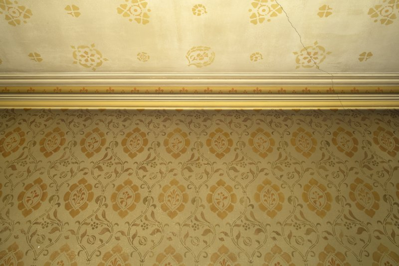 West withdrawing room. Detail of painted stencilwork on wall and ceiling