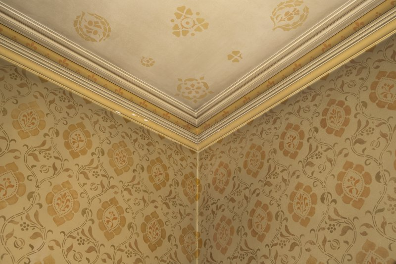 West withdrawing room. Detail of cornice with wall and ceiling painted stencilwork.