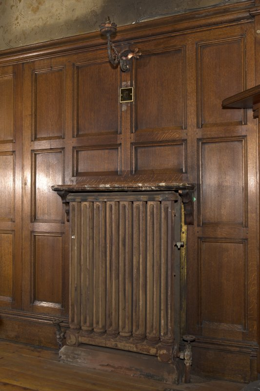 West withdrawing room. Detail of radiator with wall light above.