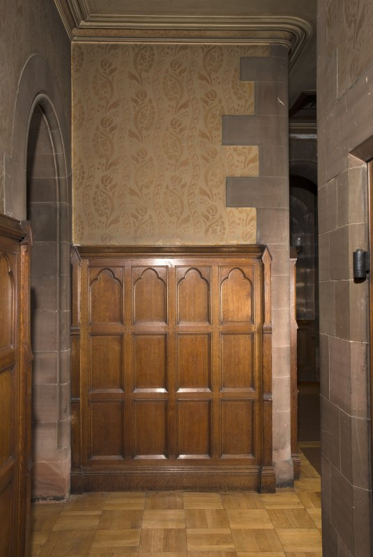 West corridor to vestry showing panelled and painted stencilled wall.
