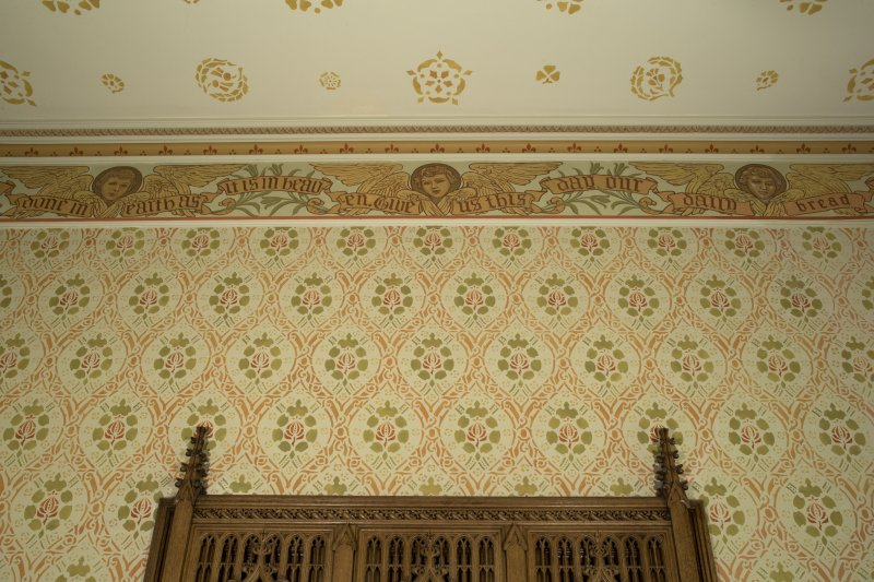 Vestry. Detail of cornice and stencill painted wall.