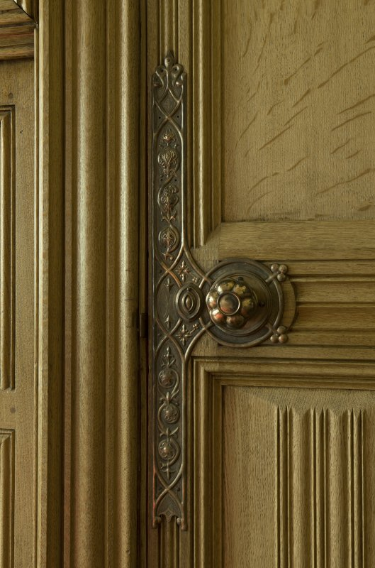 Vestry. Detail of door handle and finger plate.