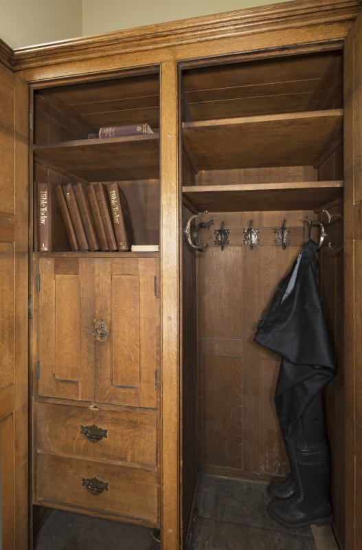 Vestry robing closet. Cupboard with waders for immersion baptisms.