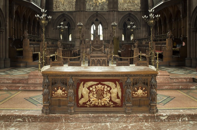 Communion table with choir stalls from south.