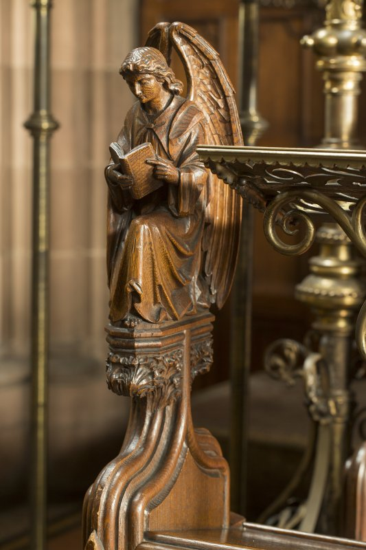 Chancel. Detail of carved angel on end of choir stall.