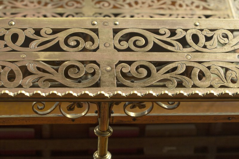 Chancel. Detail of music stand on choir stalls.