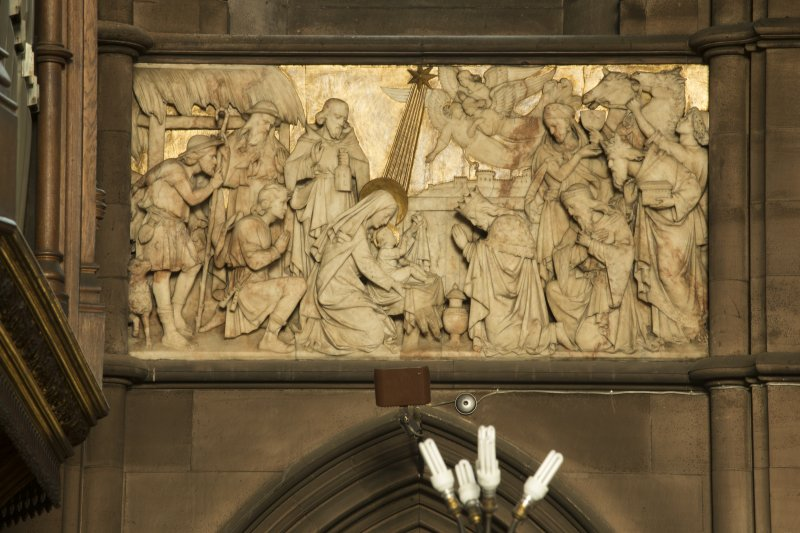 Chancel. Marble panel depicting the Nativity on north wall.