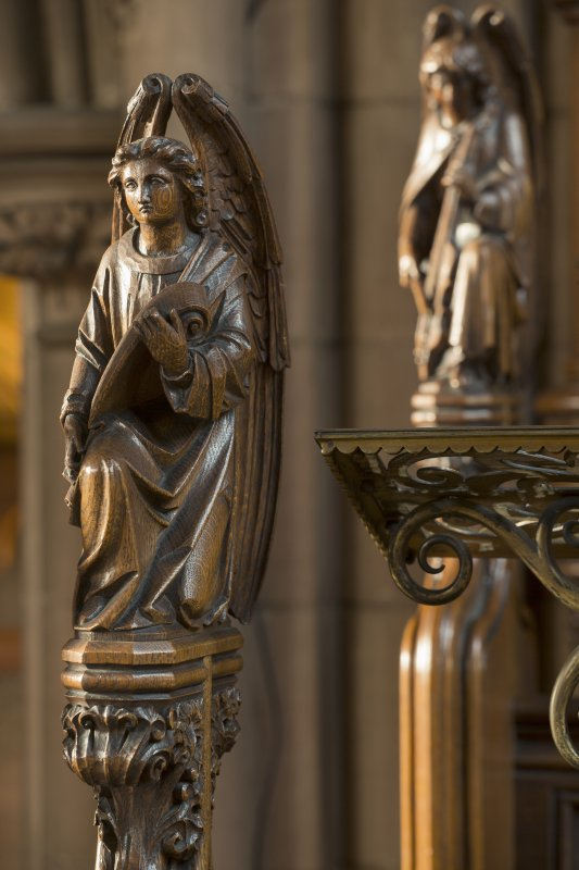Chancel. Carved angels on end of choir stalls.