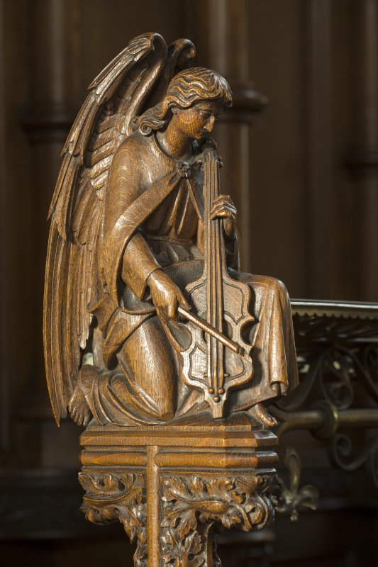 Chancel. Carved angel on end of choir stall.