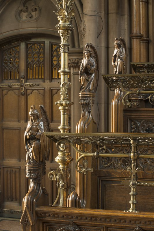Chancel. Three carved angels on end of choir stalls.