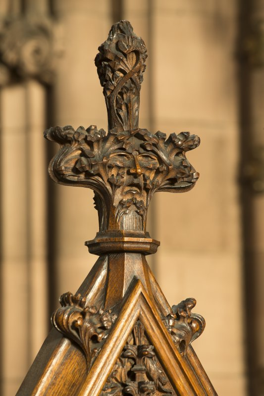 Chancel. Detail of carved face in finial of organ console.