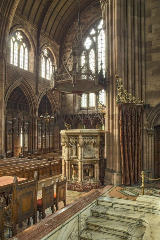 Pulpit, baptismal font and west transept from north east.