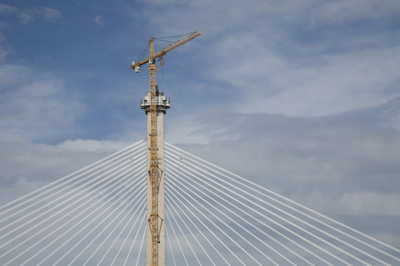 Mid tower, upper section, cables and crane, view from road bridge to east