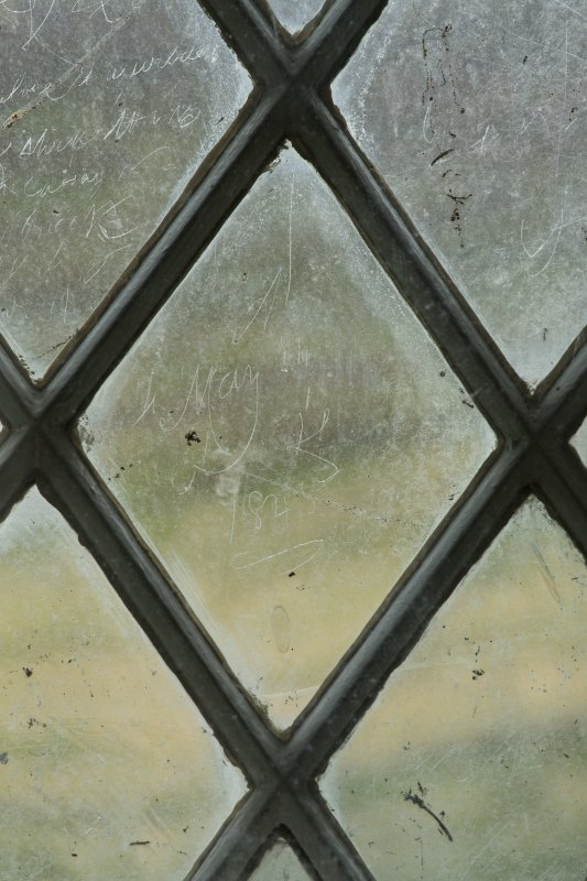 East window. Detail of writing etched on glass. (Image reversed for legibility.) 'May 24 1845'